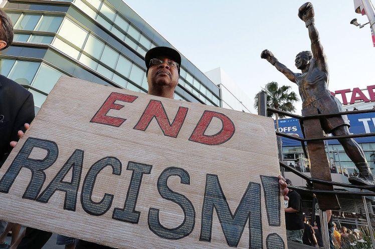RacismProtest-58bf352f5f9b58af5cd8f631